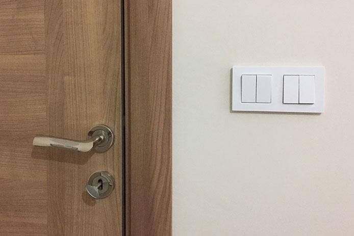 Light switch right beside door